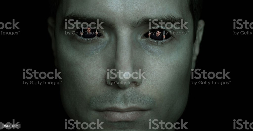 Man trapped in his own eyes, prisoner in his mind stock photo