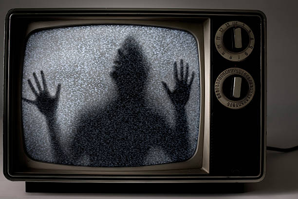 man trapped inside television stock photo