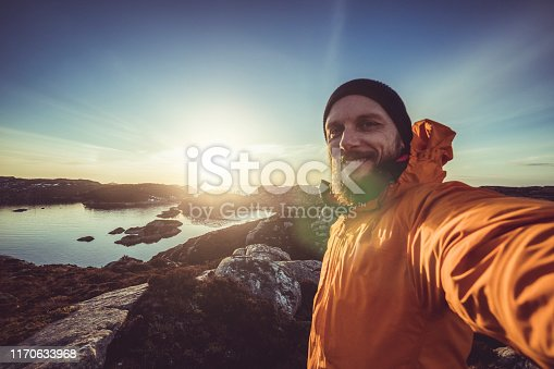 Man travel adventures: mountain hiking in Norway