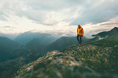 Man traveler hiking in mountains  adventure solo traveling lifestyle concept active weekend vacations wild nature