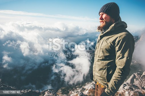 istock Man Traveler on mountain summit with clouds around Travel Lifestyle success concept adventure survival vacations outdoor 1032758740