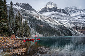 istock Man traveler standing on wooden pier with rocky mountains in Lake O'hara at Yoho national park 1204188394