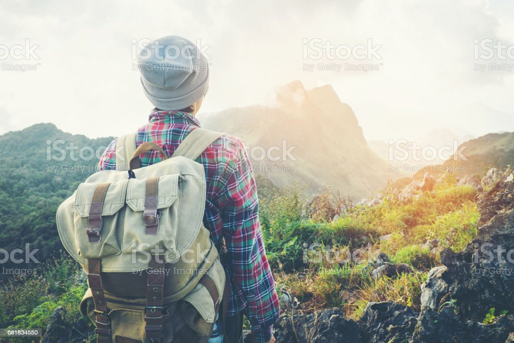 Man Traveler with backpack mountaineering Travel Lifestyle concept stock photo