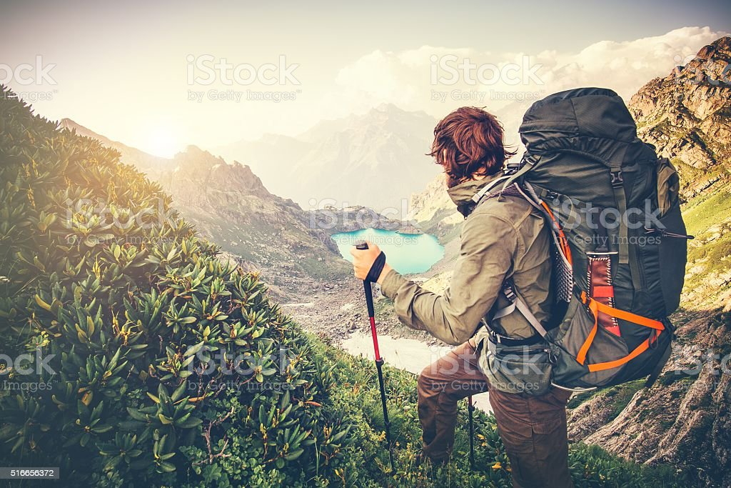 Man Traveler with big backpack mountaineering Travel Lifestyle concept stock photo