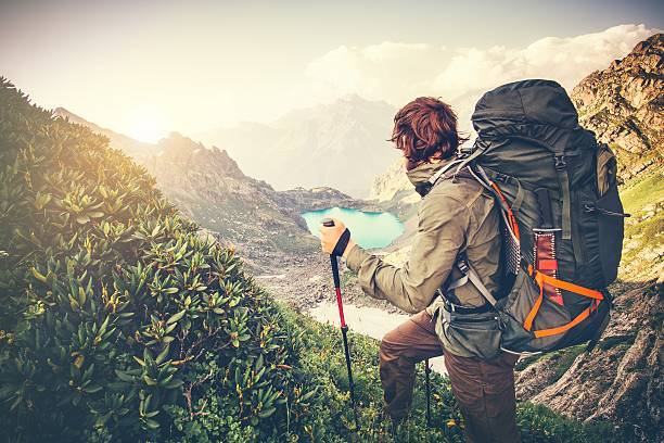 Man Traveler with big backpack mountaineering Travel Lifestyle concept Man Traveler with big backpack mountaineering Travel Lifestyle concept lake and mountains on background Summer extreme vacations outdoor explorer stock pictures, royalty-free photos & images