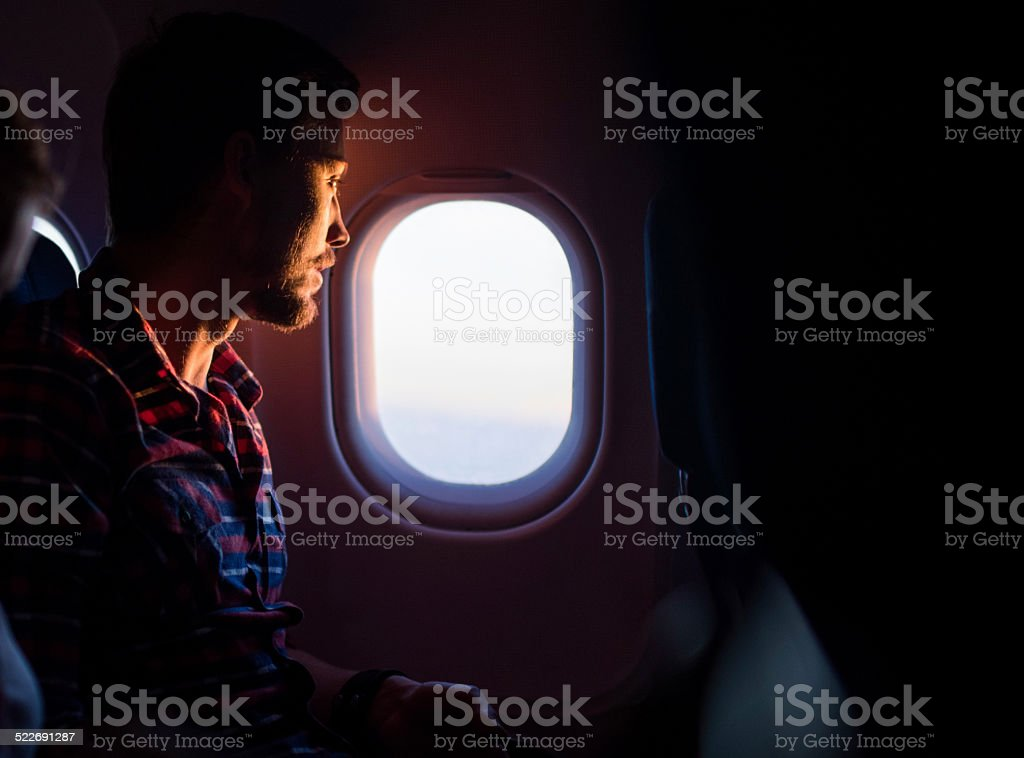 Man traveling by airplane. stock photo