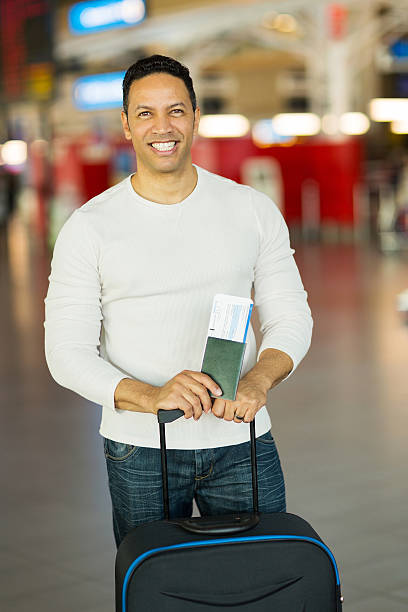Man traveling holding passport and boarding pass at airport picture id517644273?b=1&k=6&m=517644273&s=612x612&w=0&h=vojdh jwuxs4oa5ytm9rczejnfh08knmfndg3i8iyqm=