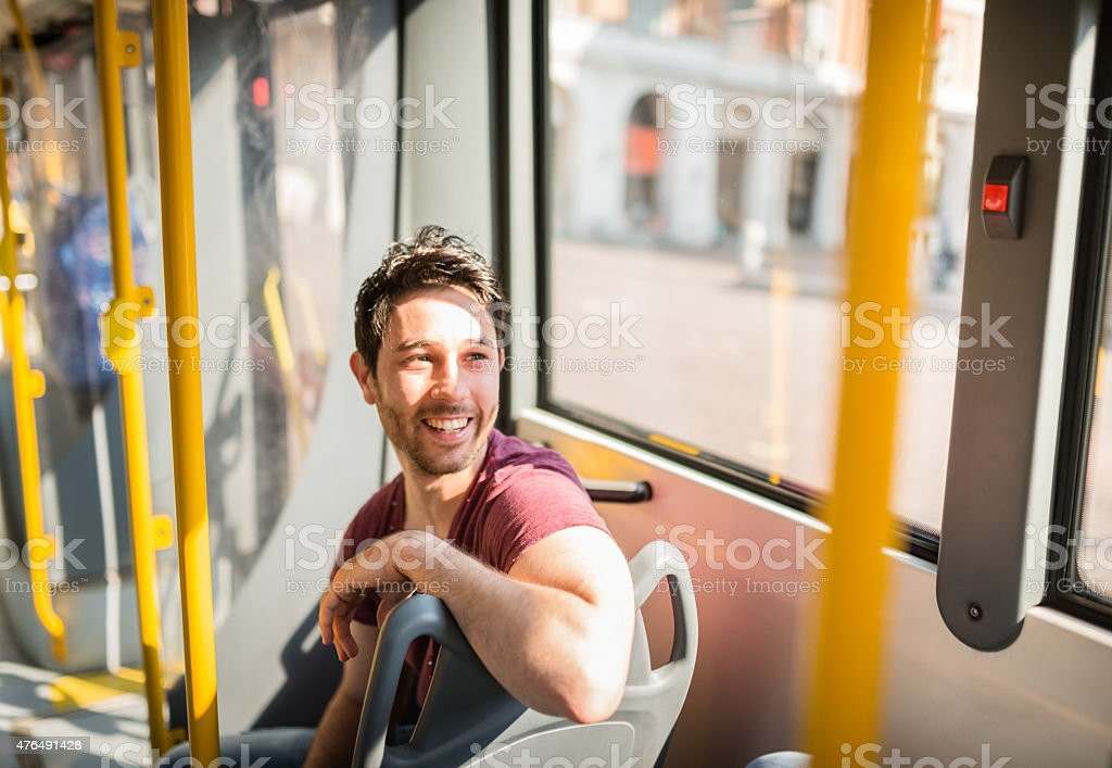 man traveling in a bus stock photo
