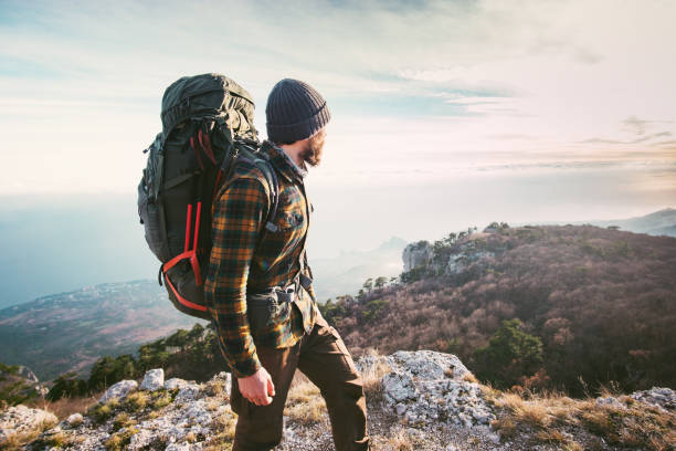 man traveling with backpack hiking in mountains travel lifestyle success concept adventure active vacations outdoor mountaineering sport plaid shirt hipster clothing - saccopelista foto e immagini stock
