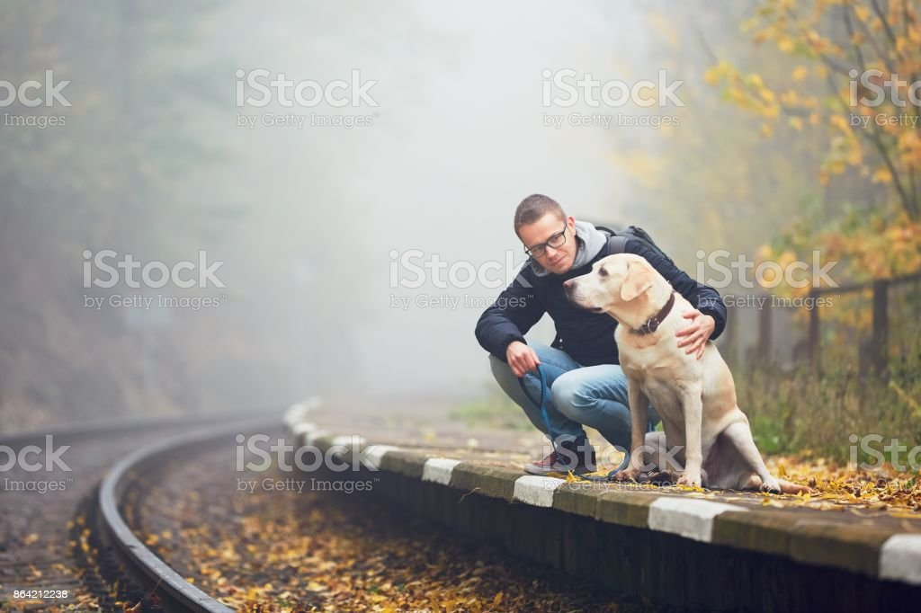 Man traveling with his dog by train royalty-free stock photo