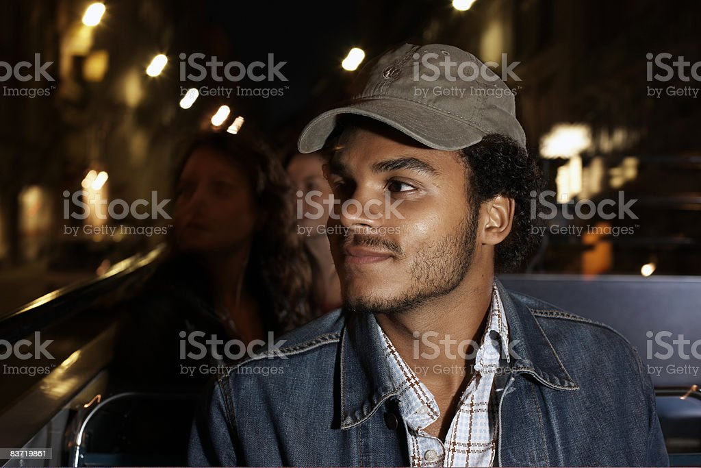 Man travelling on open top bus royalty-free stock photo