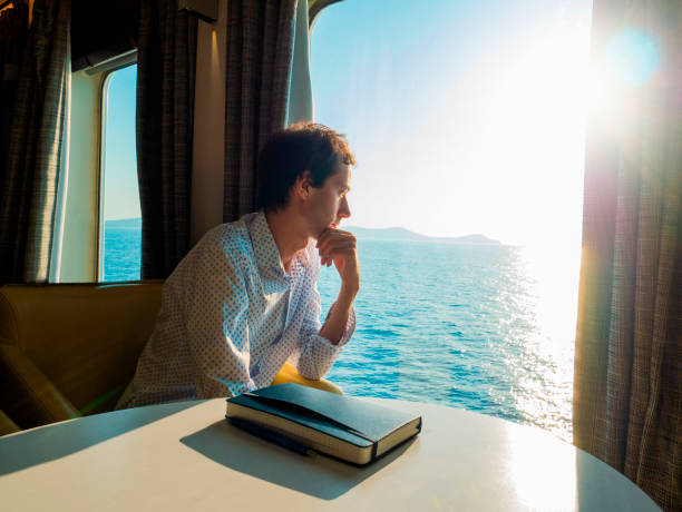 Man travels by ship stock photo