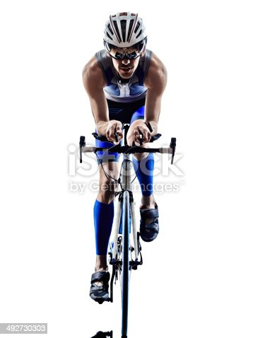 istock man triathlon ironman athlete cyclists bicycling 492730303