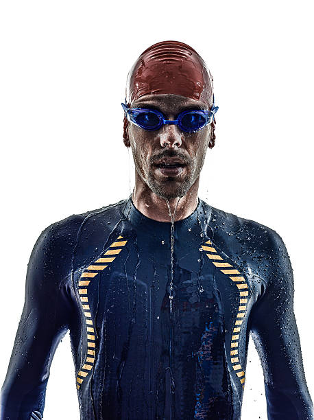 man triathlon ironman athlete swimmers portrait man triathlon ironman athlete swimmers portrait in silhouette on white background wetsuit stock pictures, royalty-free photos & images