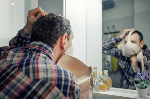 A man tries to protect himself against the coronavirus with his wife bra. stock photo