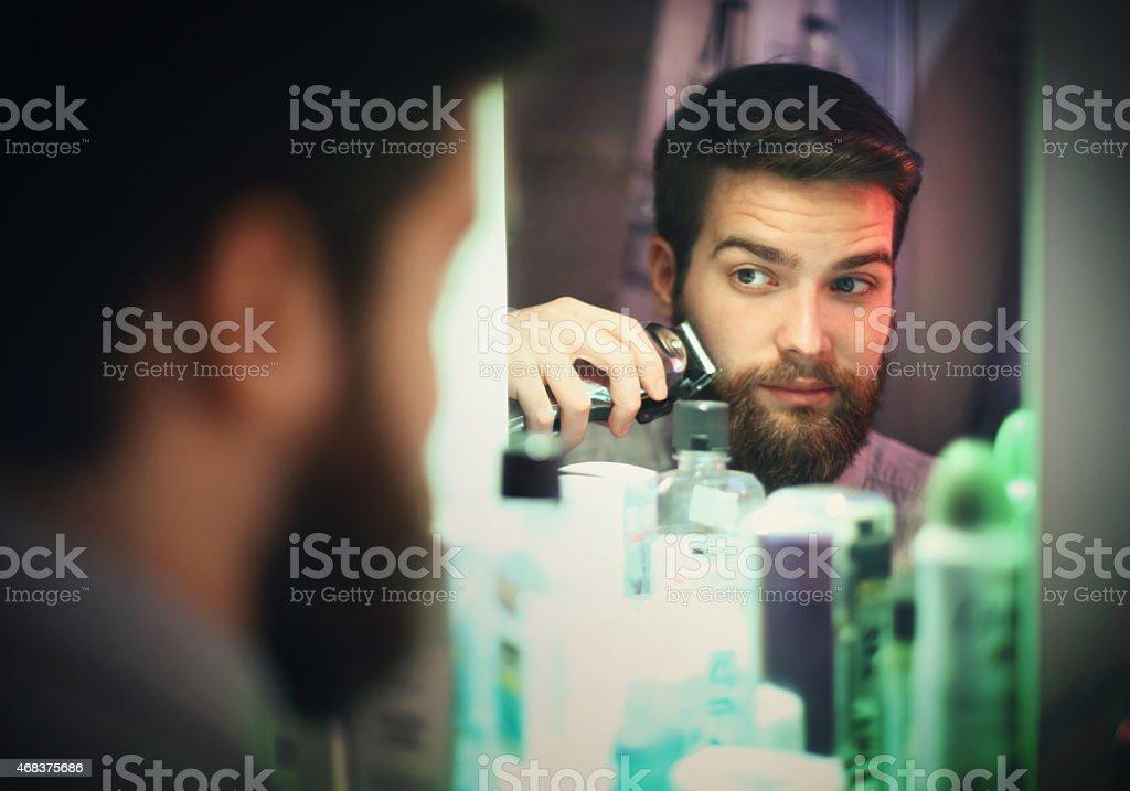 Man trimming beard. stock photo