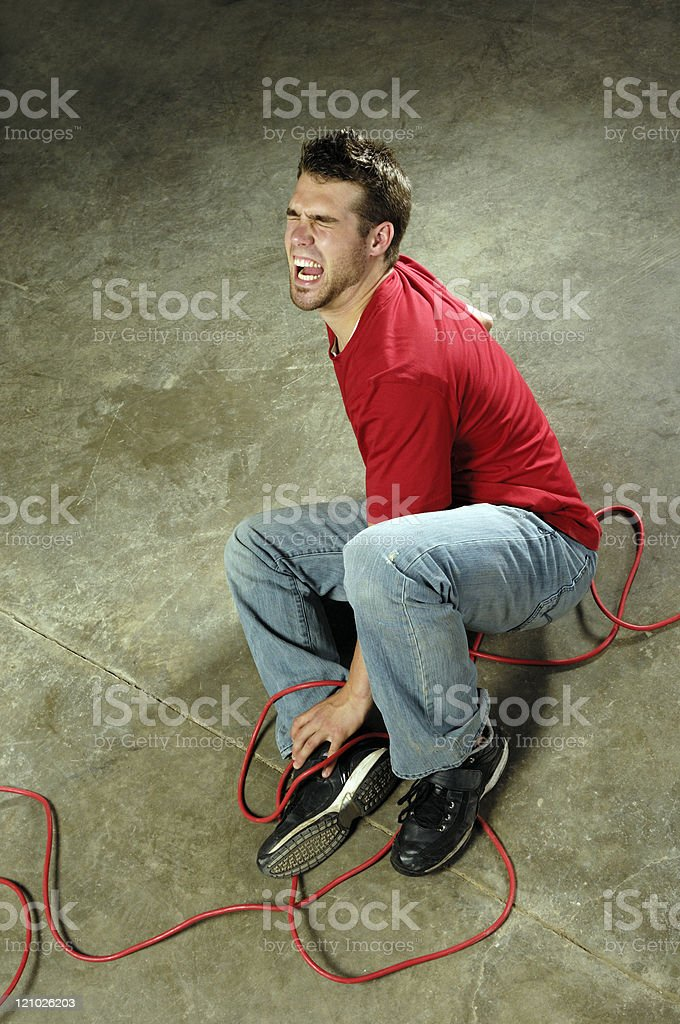 Man tripping over cable stock photo