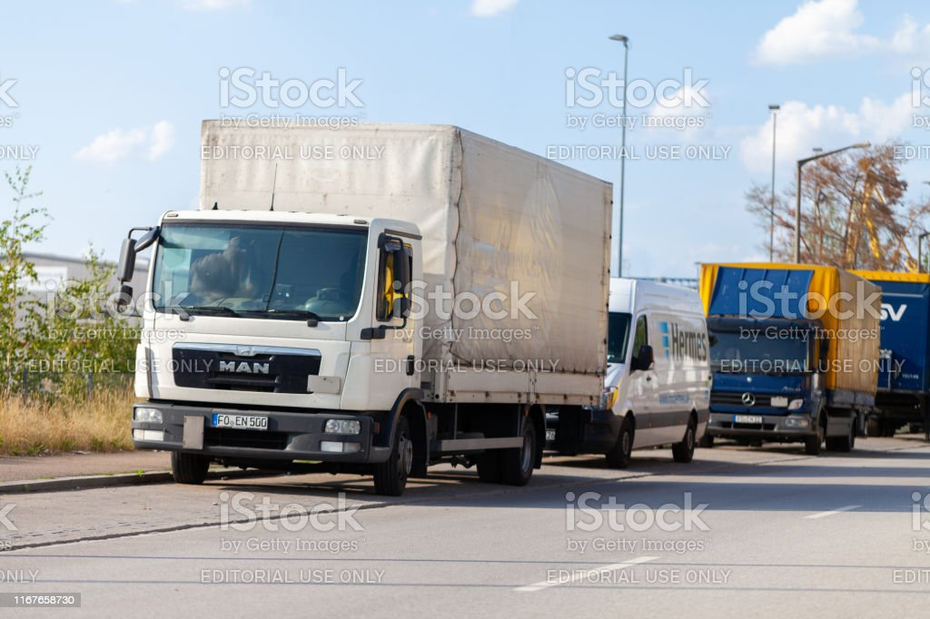 Man truck from a forwarder company stands on a street.