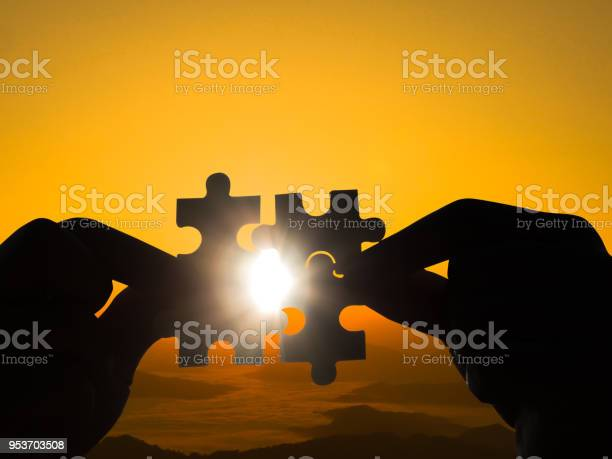 Man trying to connect four pieces of jigsaw in sunset background picture id953703508?b=1&k=6&m=953703508&s=612x612&h=itjgfasoh9eonpad3mlzhbirgesfbcmedn1oxzqrg4w=