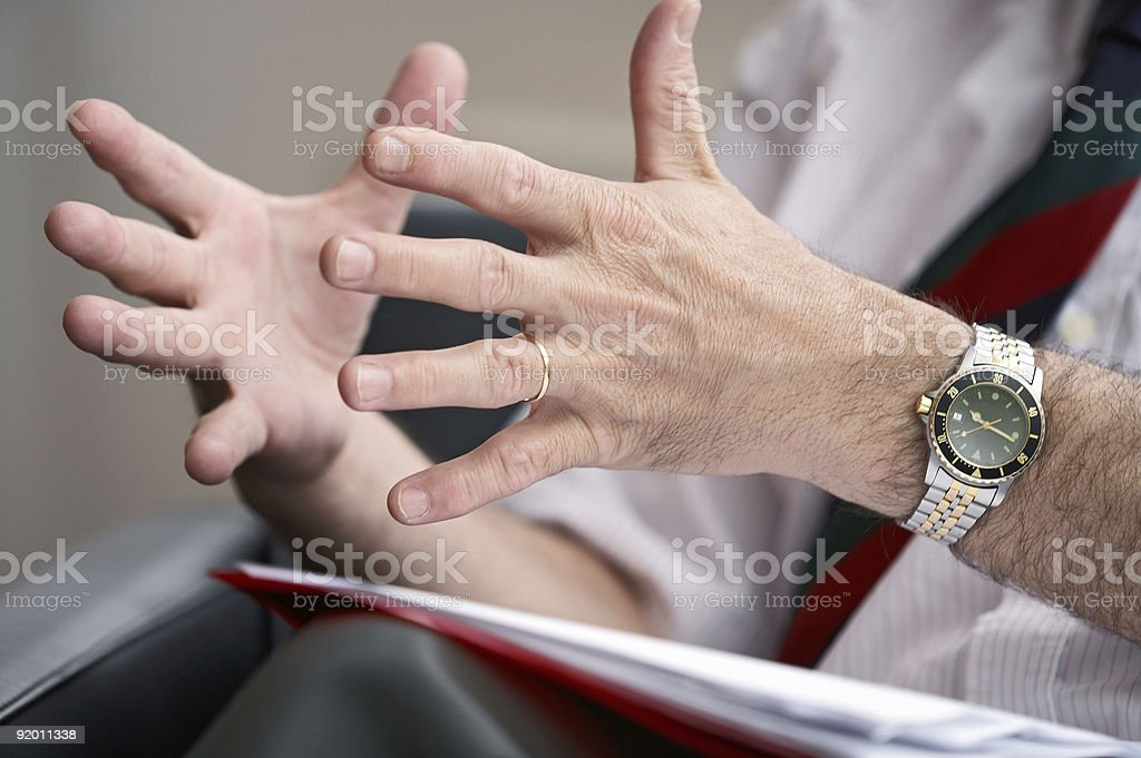A man trying to express something using his two hands stock photo
