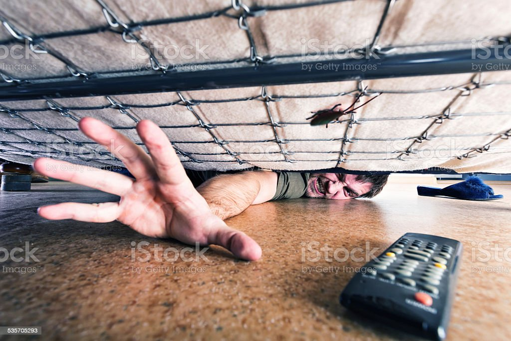 Man trying to get something stock photo
