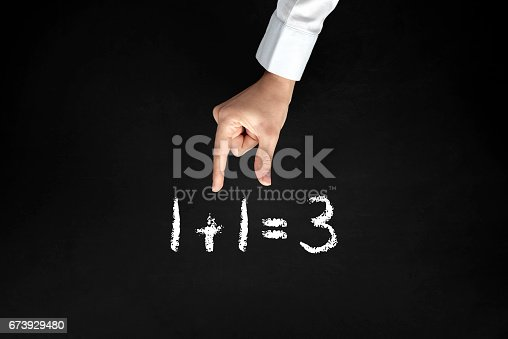 532357605istockphoto A man trying to hold number 1 from 1+1=3 673929480