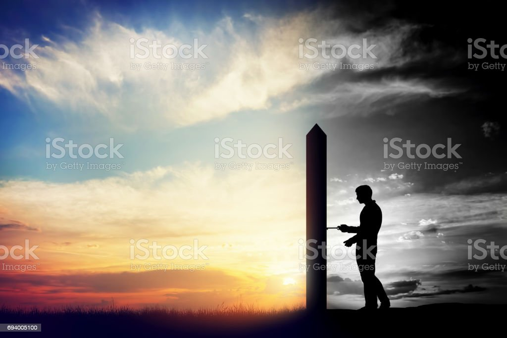 Man trying to open door to new better world. Conceptual change, two worlds stock photo