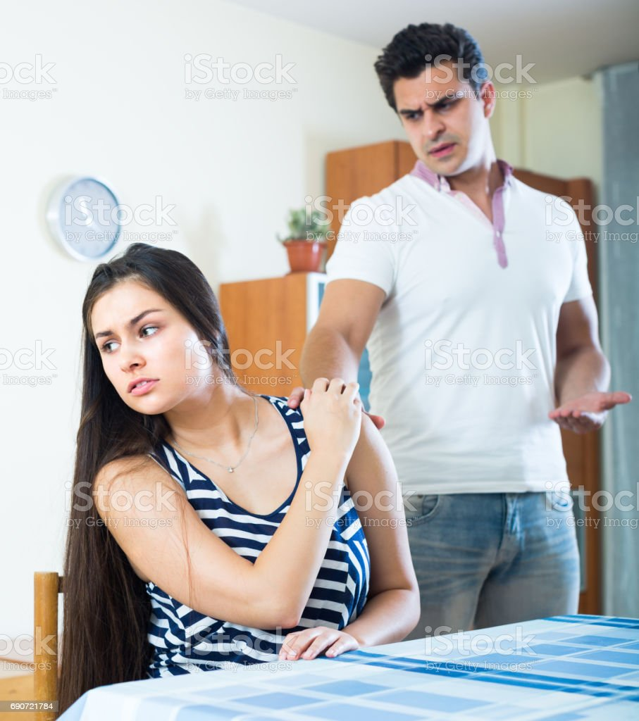 Man trying to reconcile with woman stock photo