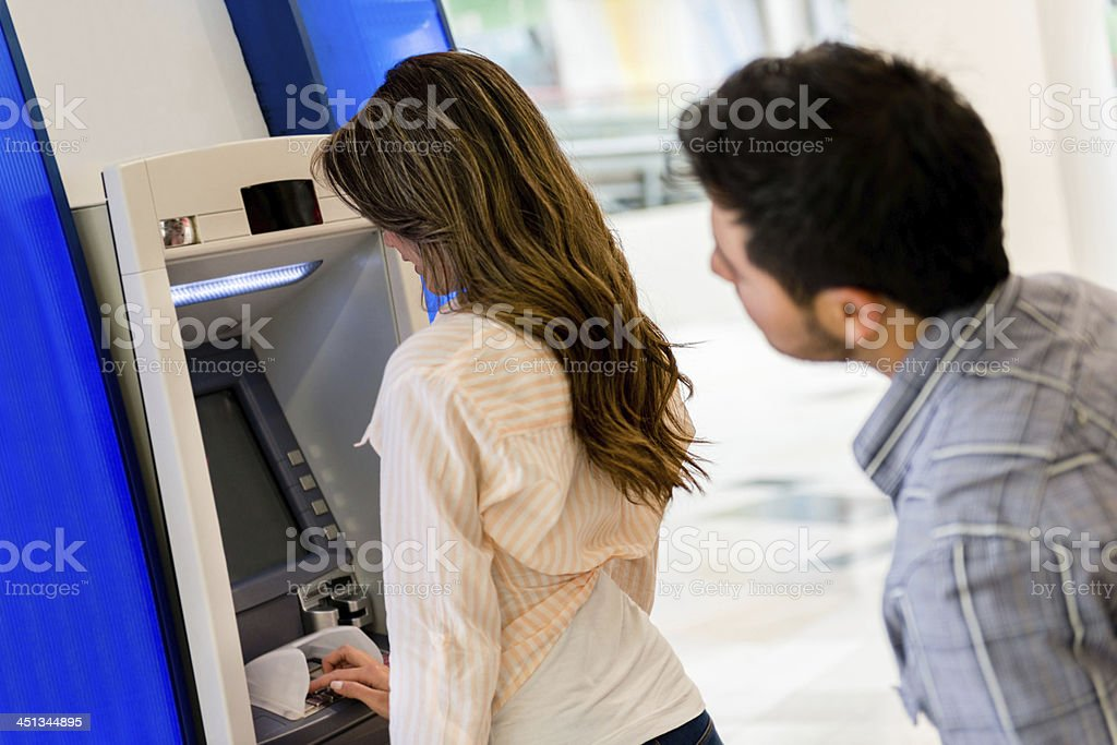 Man trying to see her PIN entry stock photo