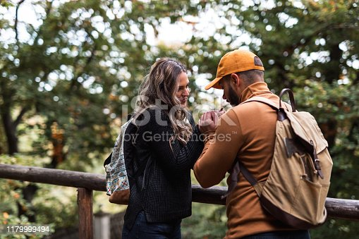 Man trying to warm his girlfriend`s hands