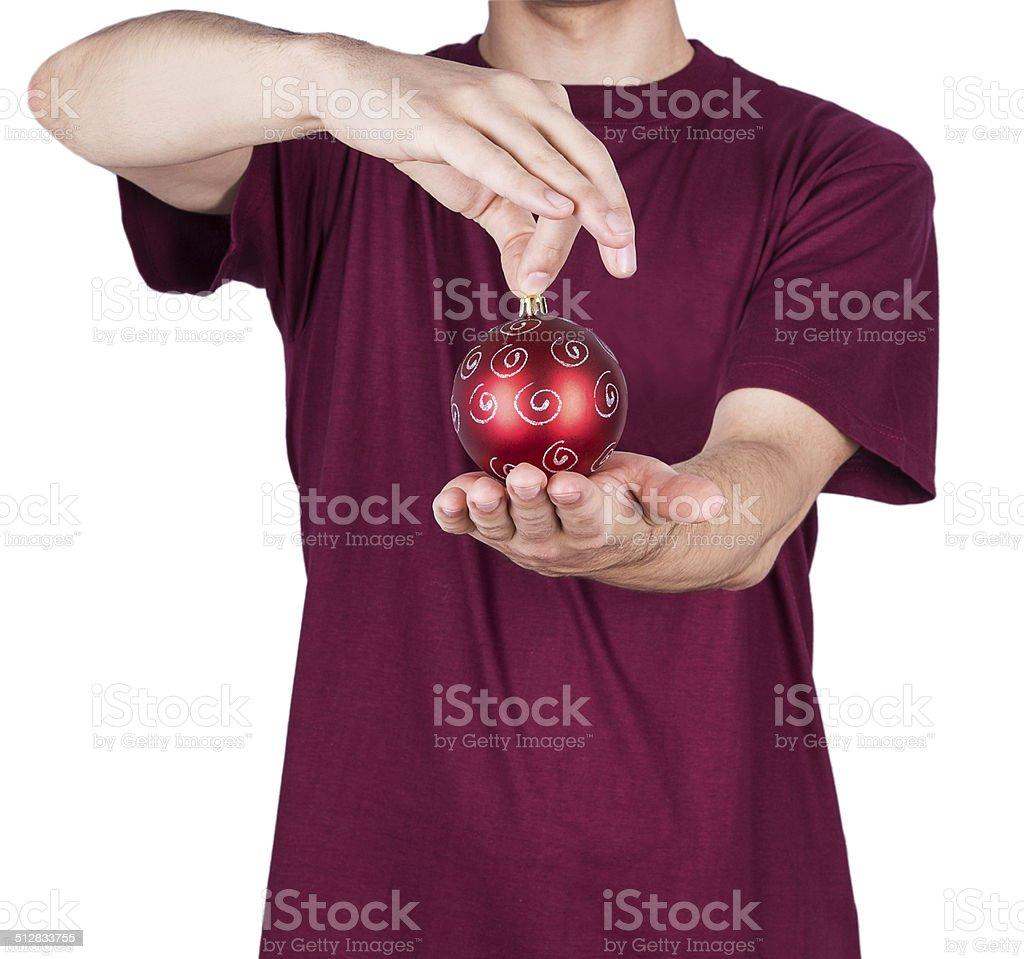 man T-shirt Christmas ball stock photo