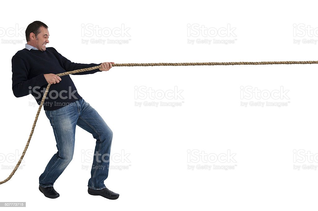 man tug of war pulling rope isolated stock photo