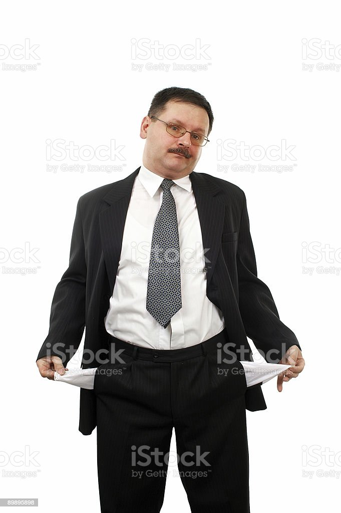 Man turning his empty pockets inside royalty-free stock photo