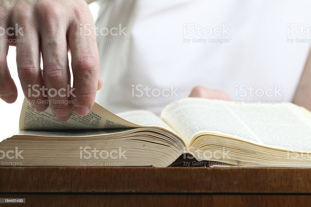 Man turning the page of Bible royalty-free stock photo