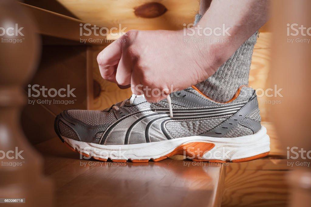 Man tying jogging shoes royalty-free stock photo