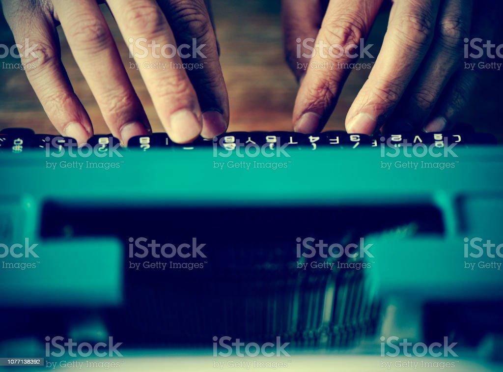man typewriting, filtered