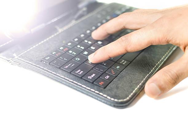 Man typing laptop keyboard stock photo