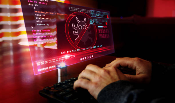 Man typing on keyboard with virus detected alert on hologram screen Virus detected alert. Camera moves around hud display and man typing keyboard. Cyber security breach warning with worm symbol on screen. System protection futuristic concept. malware stock pictures, royalty-free photos & images