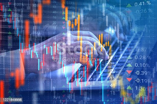 Stock market trader analyzing data using laptop application on virtual reality interface