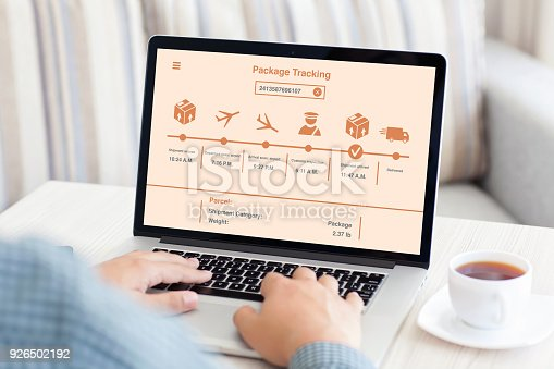 istock man typing on laptop keyboard with package delivery tracking screen 926502192