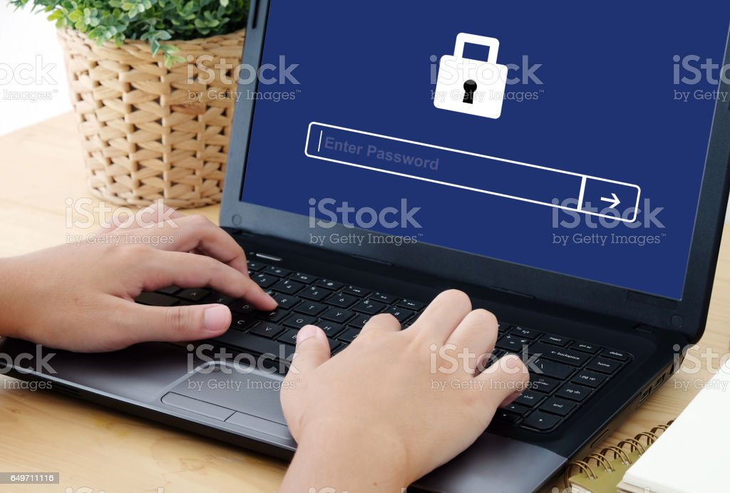 Man typing password on labtop screen background, cyber security concept stock photo