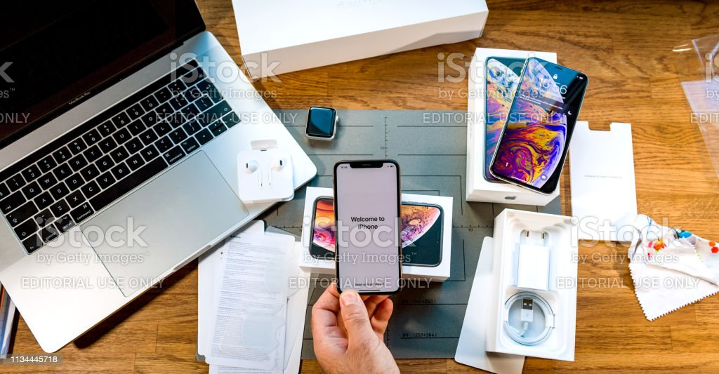 Man Unboxing Latest Iphone Xs And Apple Watch Series 4 Stock