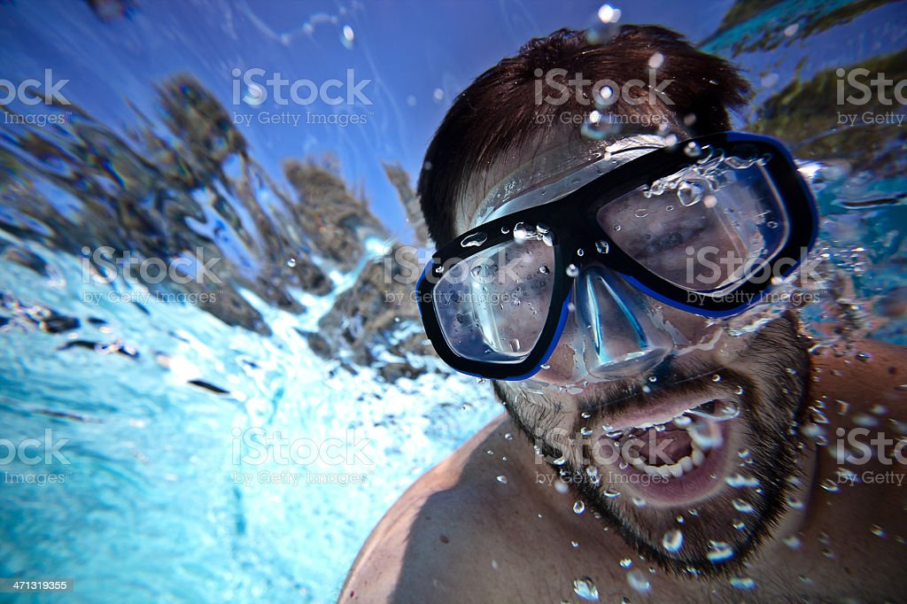 Man underwater in a swimming pool royalty-free stock photo