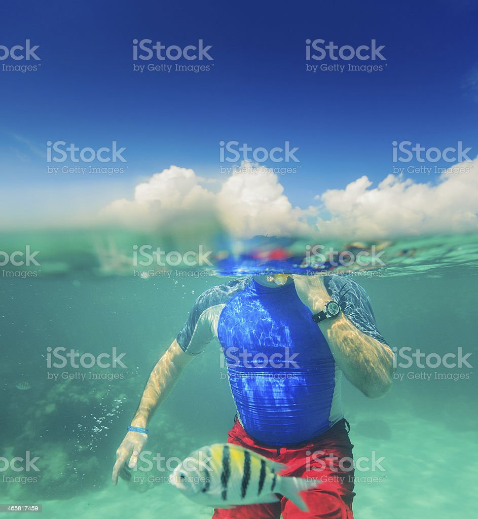 man underwater stock photo