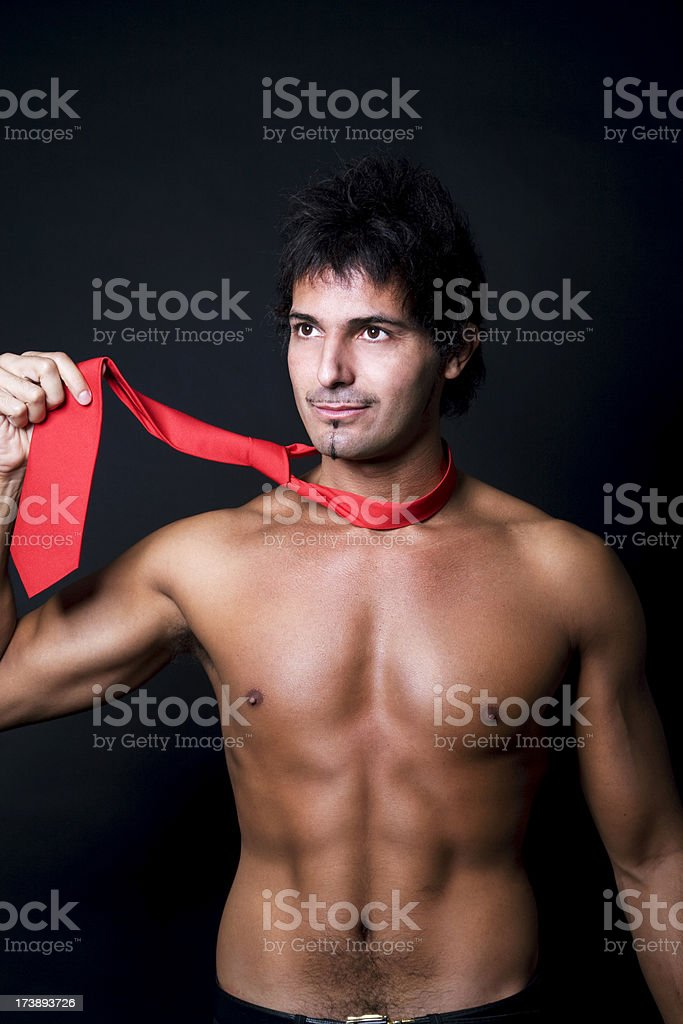 Man Undressing After Work stock photo