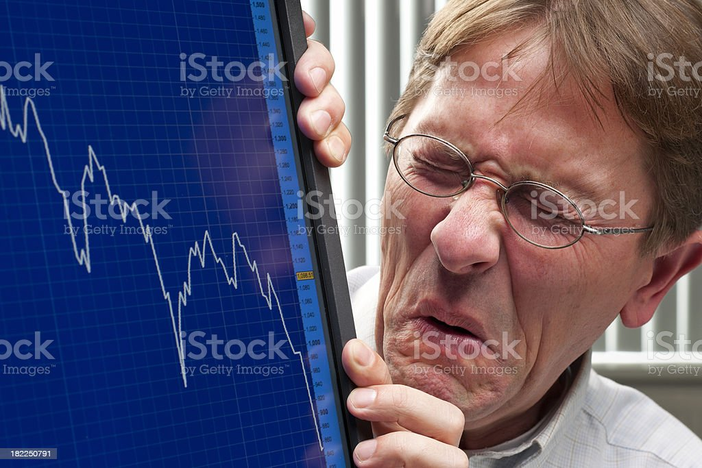 man unhappy about sinking stock exchange rate stock photo