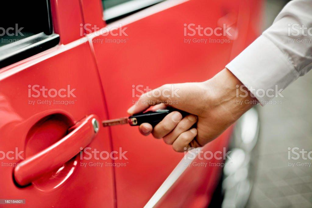 Man unlocking car door royalty-free stock photo