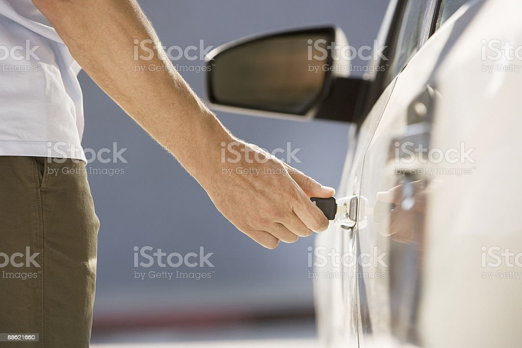 Man unlocking car door royalty-free stock photo