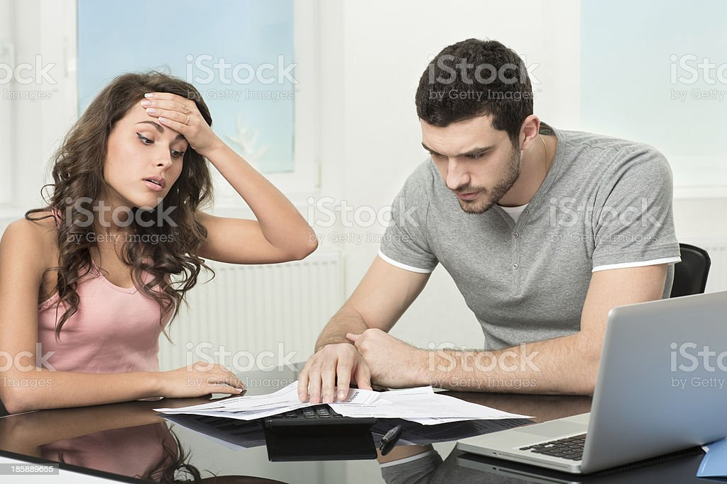 man upset after looking at card statement. stock photo