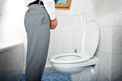 man urinating standing up